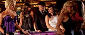 Attractive women surrounding a table game